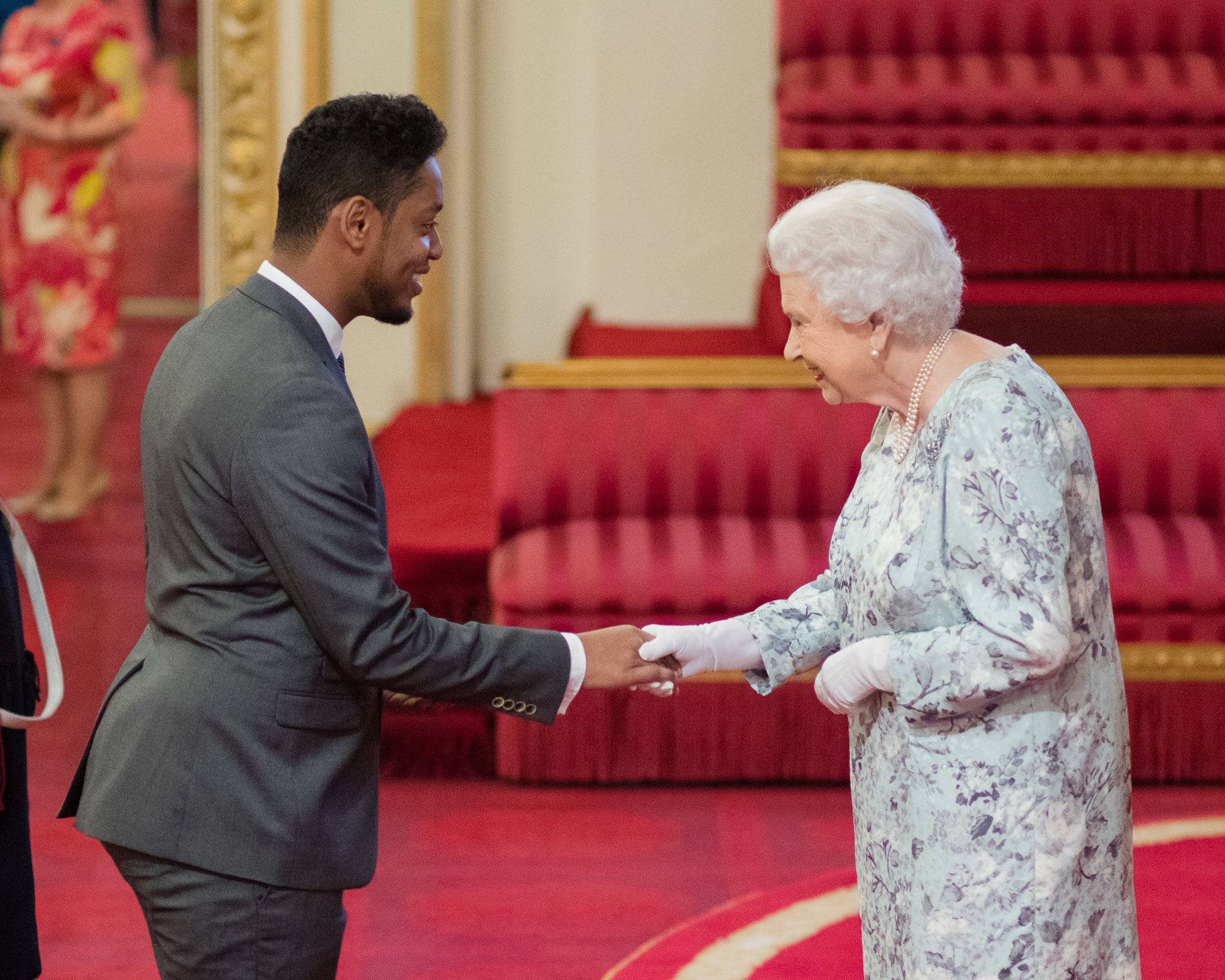 Abdullahi ALim receiving his Queen's Young Leaders Award from Her Majesty The Queen