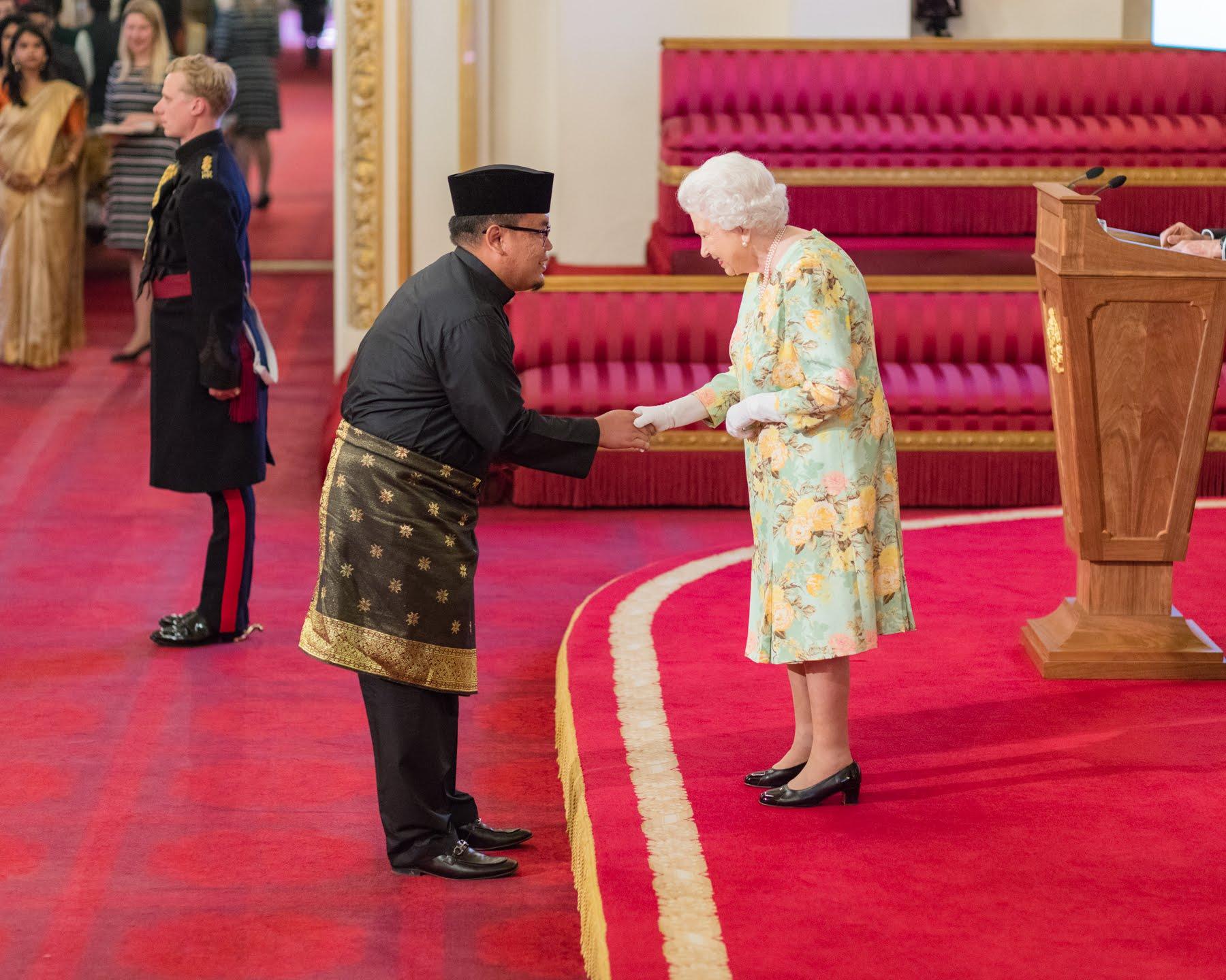 Ahmad Faddillah Sellahuddin with The Queen